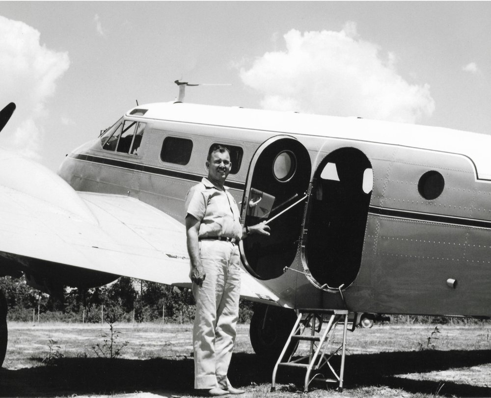 Claud Holbert beside aircraft.jpg