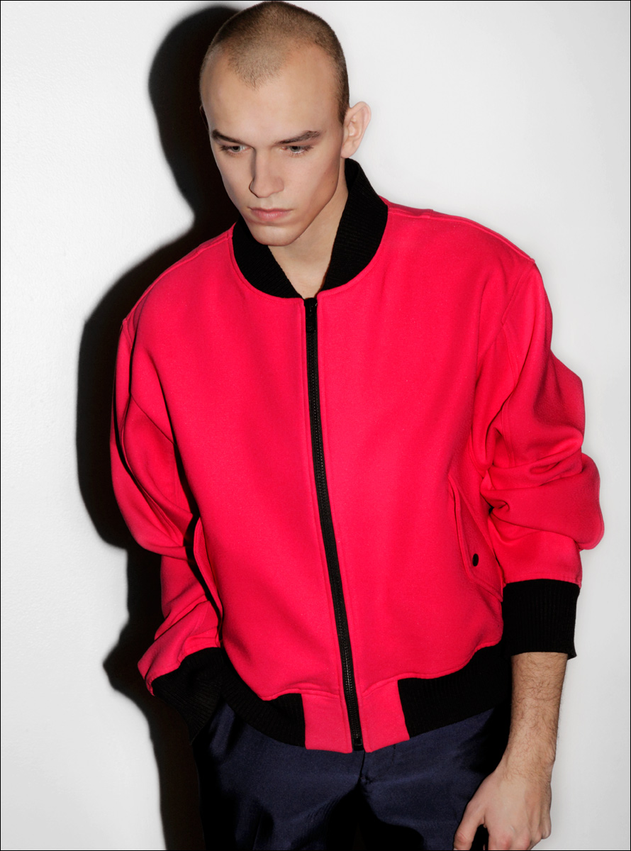 Model in red bomber
