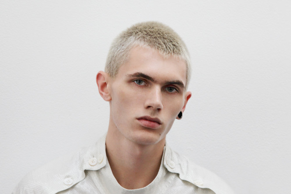 Male model backstage at Duckie Brown