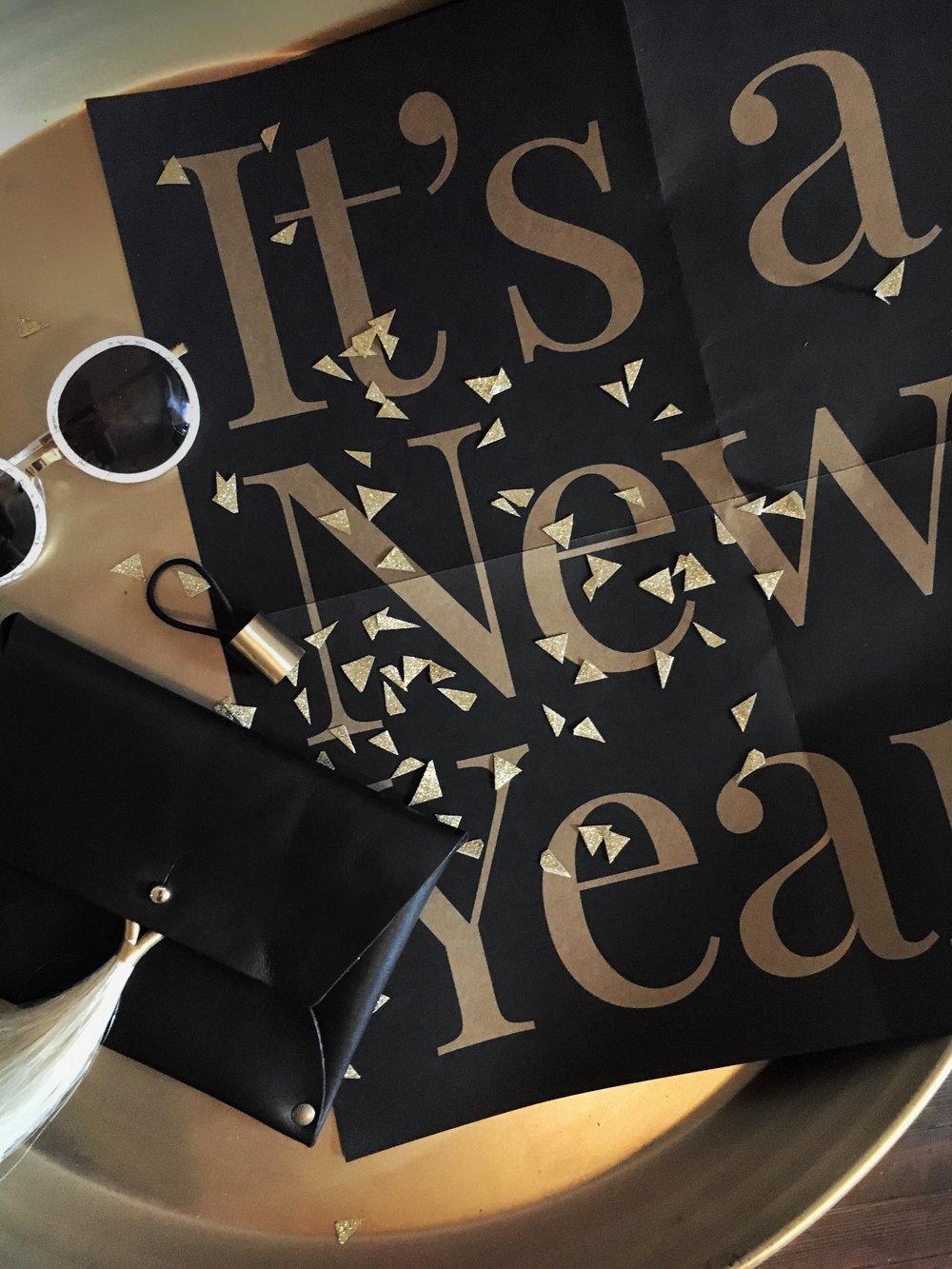 black-leather-clutch-happy-new-year.jpg