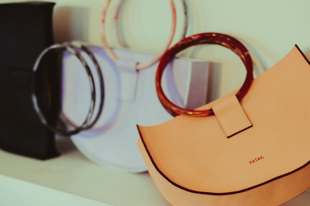 ATELIER BATAC - Handcrafted one by one in Barcelona, these geometric bags pair vintage lucite with luxe leather.