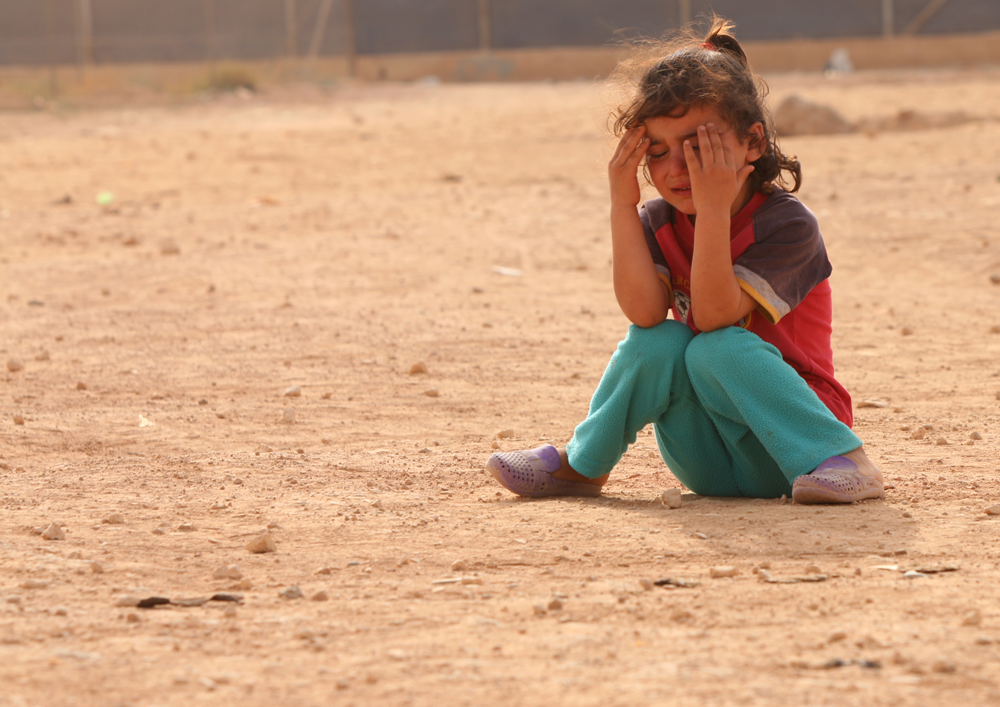 Syrian child refugee portrait crying girl