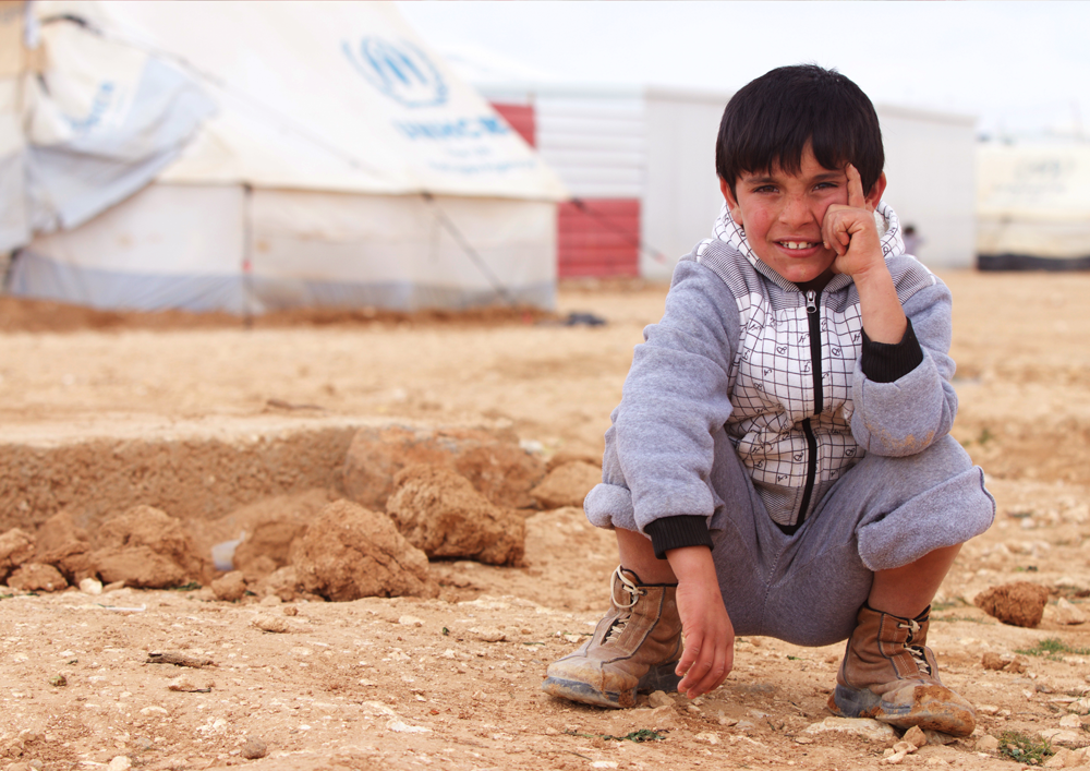 Syrian refugee sitting child portait