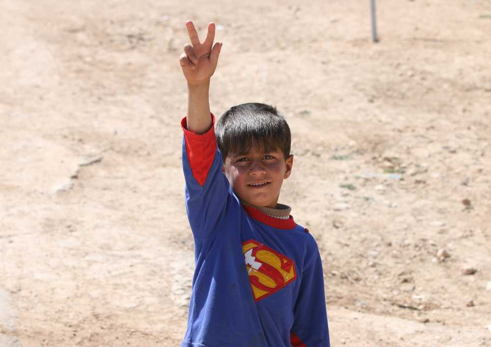 Syrian refugee child superman
