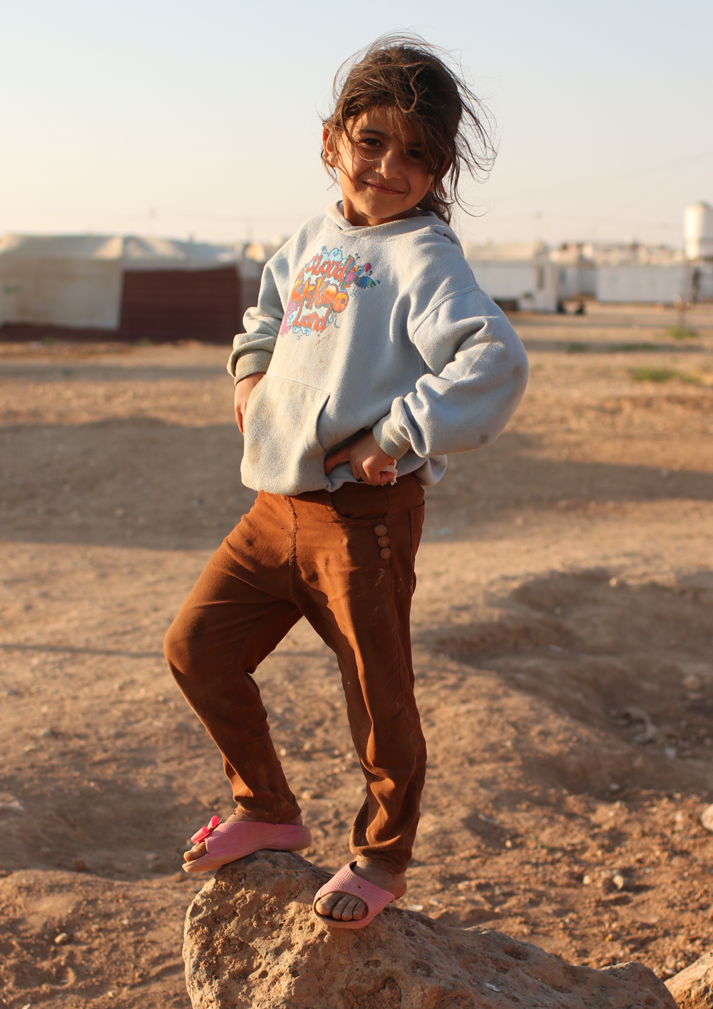 Syrian refugee girl on rock