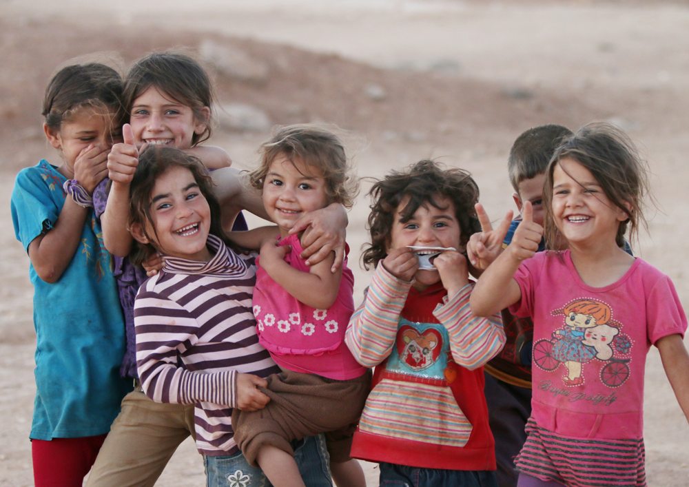 Refugee camp smiling children