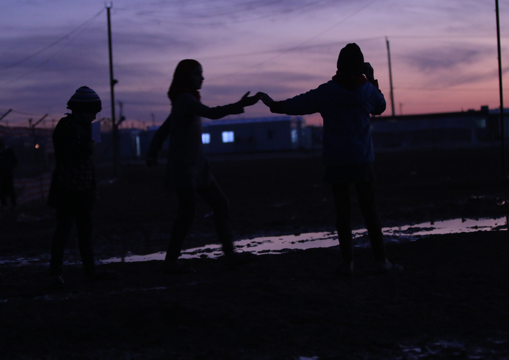 Syrian refugees at twilight Zaatari