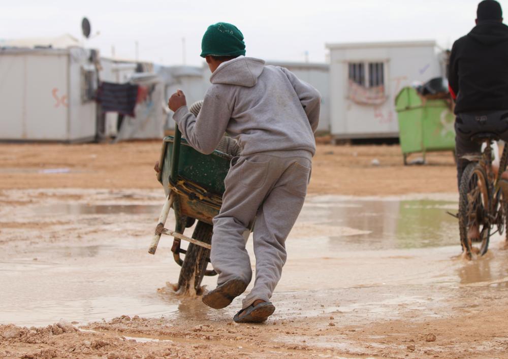 Syrian boy with wheelbarrow