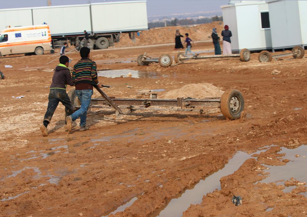 Syrian children work in refugee camp