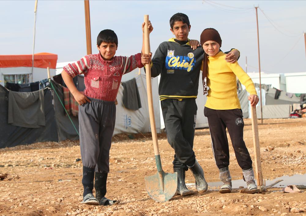 Syrian children trio work in refugee camp