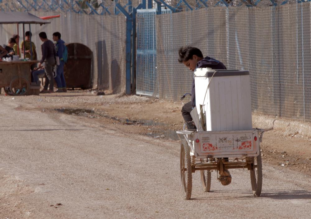 Syrian boy bicycles