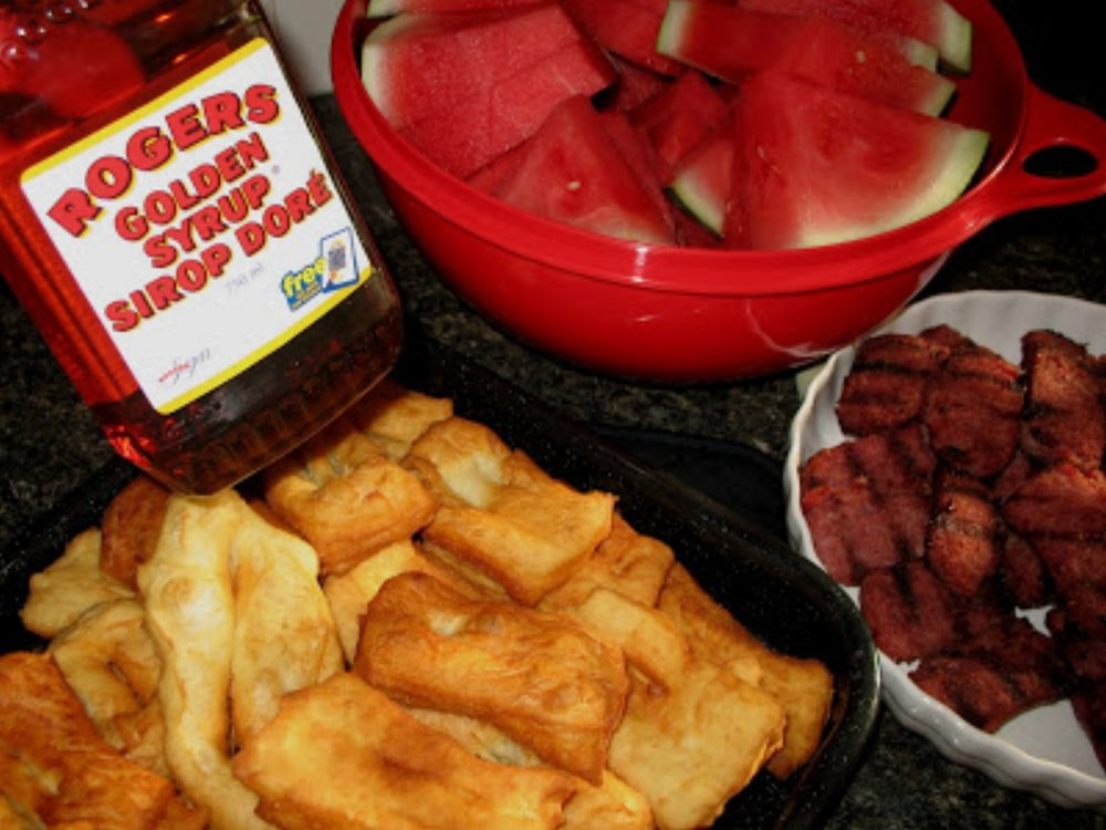 Rollkuchen, watermelon, farmer sausage, and syrup!Photo from Mennonite Girls Can Cook.