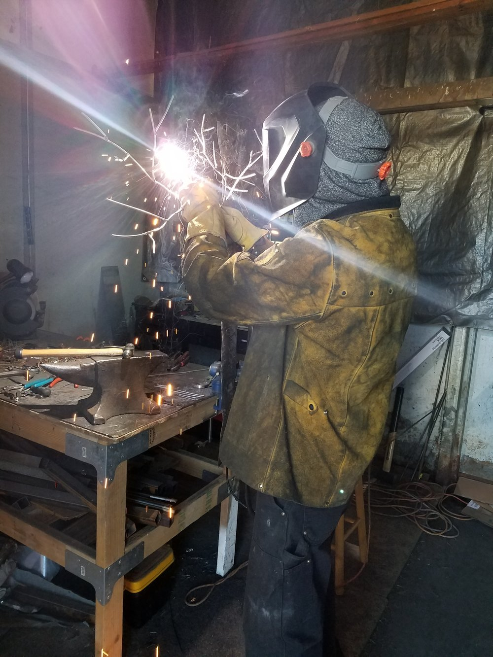 Wes welding in the barn studio, Gunnison, Colorado. 2017