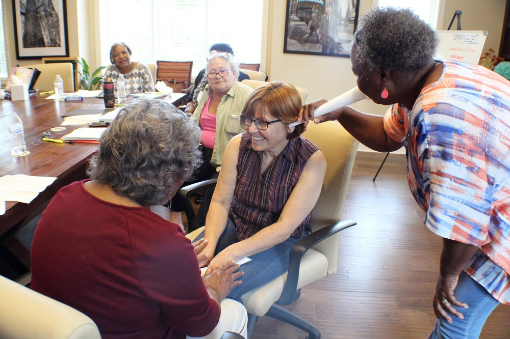 Participants experience a glimpse of what those with dementia go through during a recent Stress Busters class hosted at Caring Days.