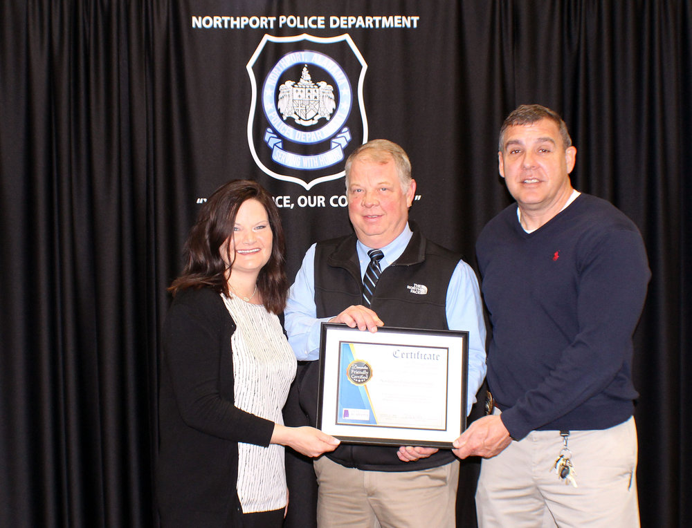 Nikki Poe, Aging Services Coordinator at West Alabama Area Agency on Aging, presents Northport Assistant Police Chief Keith Carpenter and Lt. Mark Glenn with a certificate of completion. 82 members of the NPD recently completed Dementia Friendly Training making them the first law enforcement agency in West Alabama to do so.