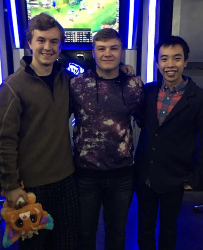 "Jack Counts (left) and Alex tu (right) pose with Cole ""Adramtor"" Meritt, Mid laner for the gold-capped team Vengance, at the OKLCS season two finals."