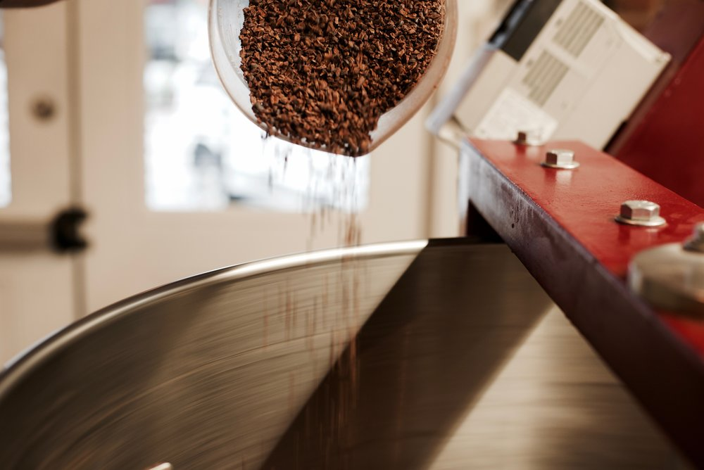 The sorted beans are then cracked and winnowed into cocoa nibs. At that point, the team pours the nibs into an industrial sized grinder with stone wheels. This will continuously crush the nibs until they are in a liquid state. This part of the operation takes about 24 hours.