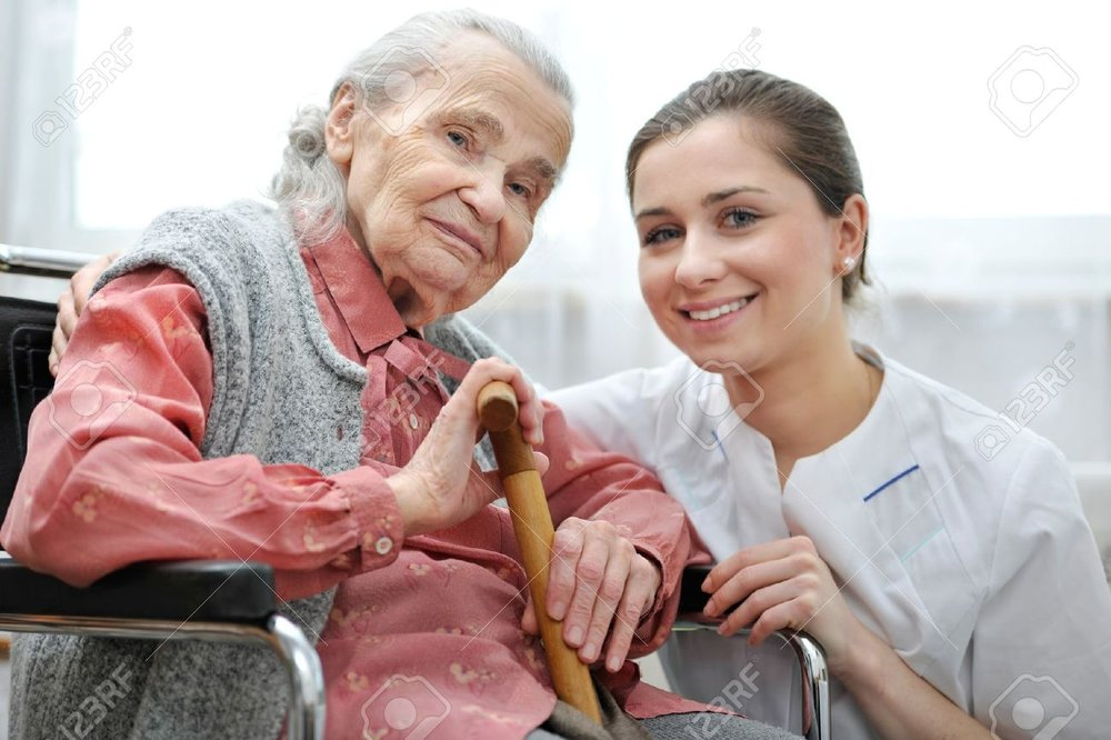 18916070-Senior-woman-with-her-caregiver-at-home-Stock-Photo-care-home-elderly.jpg
