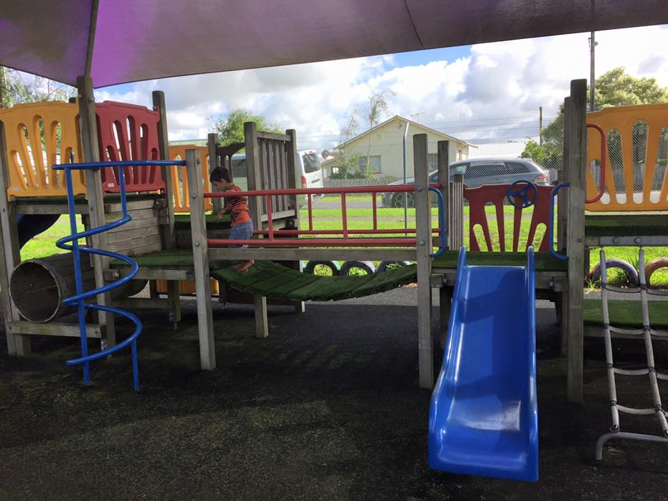 Plenty of Outdoor Play Equipment in a full fenced facility.