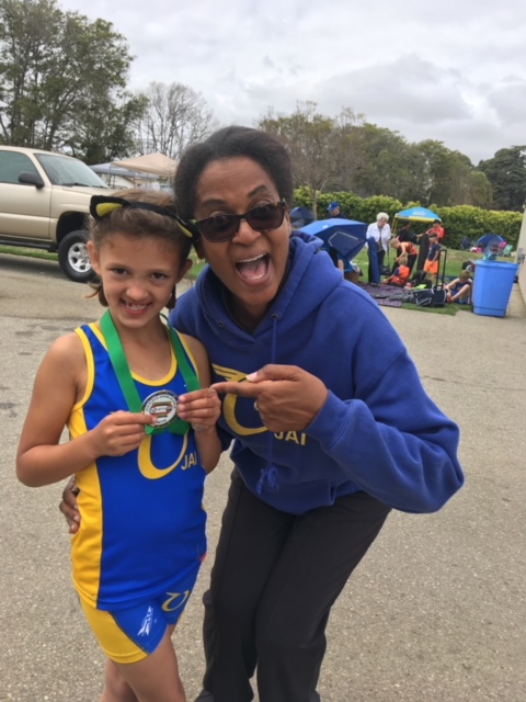 Hazel Williams and Tiarzha Taylor, VP of the Ojai Roadrunners, celebrates Hazel's 4th Place Ribbon in the 800 m!