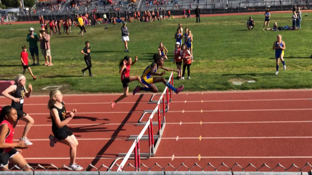 Ava Everett on her way to her 1st Place finish in the Hurdles!