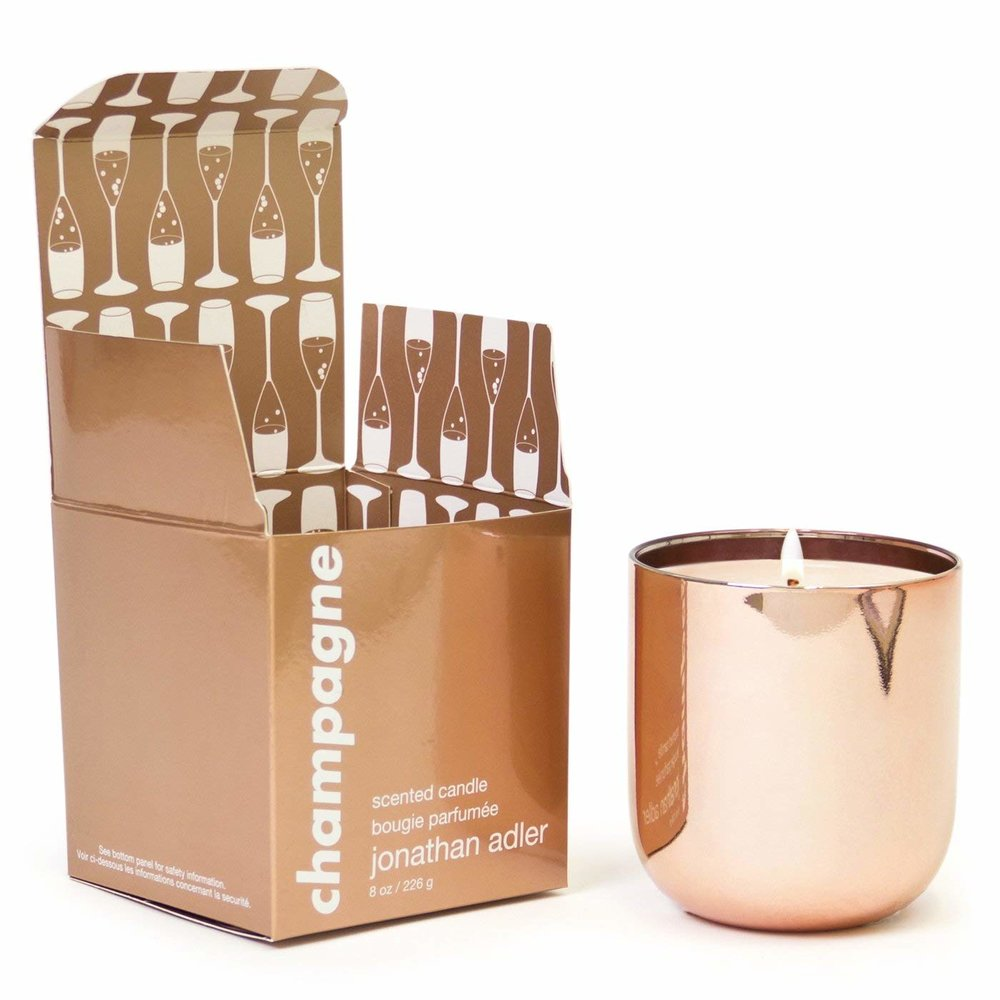 champagne scented candle  First of all, isn't the rose gold holder just everything? I can see using that container well after the candle is gone. but, hello! Champagne scented? i'm pretty sure it doesn't get better than that!.