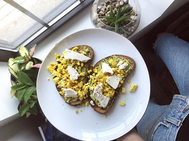 Scrambled tofu, avo, and Miyokos vegan cheese on sourdough bread = breakfast of champions ✨