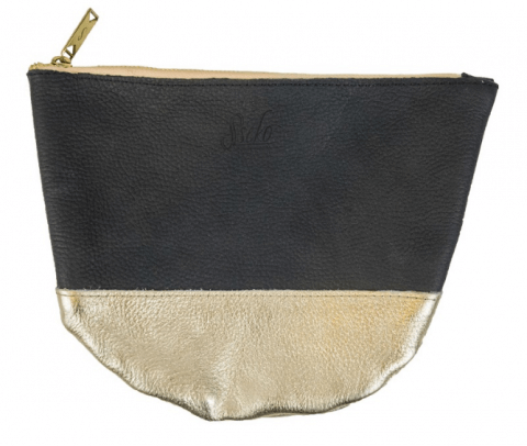 Sseko Moon Clutch | $29.99 - The Sseko Medium Moon Clutch in gold and black is made from beautiful leather in Ethiopia. I had the opportunity to visit one of Sseko's workshops in Uganda over the summer, and the women were so inspiring! The Half Moon Clutch is perfect to use as a pouch for travel essentials, as a make-up bag, or as a clutch for a night out! It has so many uses!
