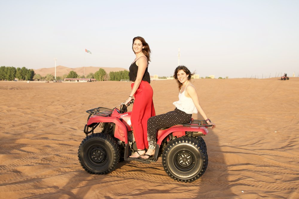 Eira and I driving through the dunes as part of the desert Safari activity.
