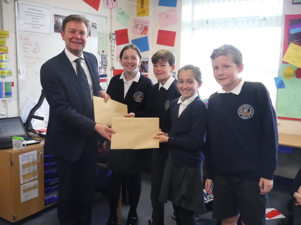Chilton Primary School pupils presenting Craig with letters arguing that the UK must strive to meet the UN Global Goals by 2030