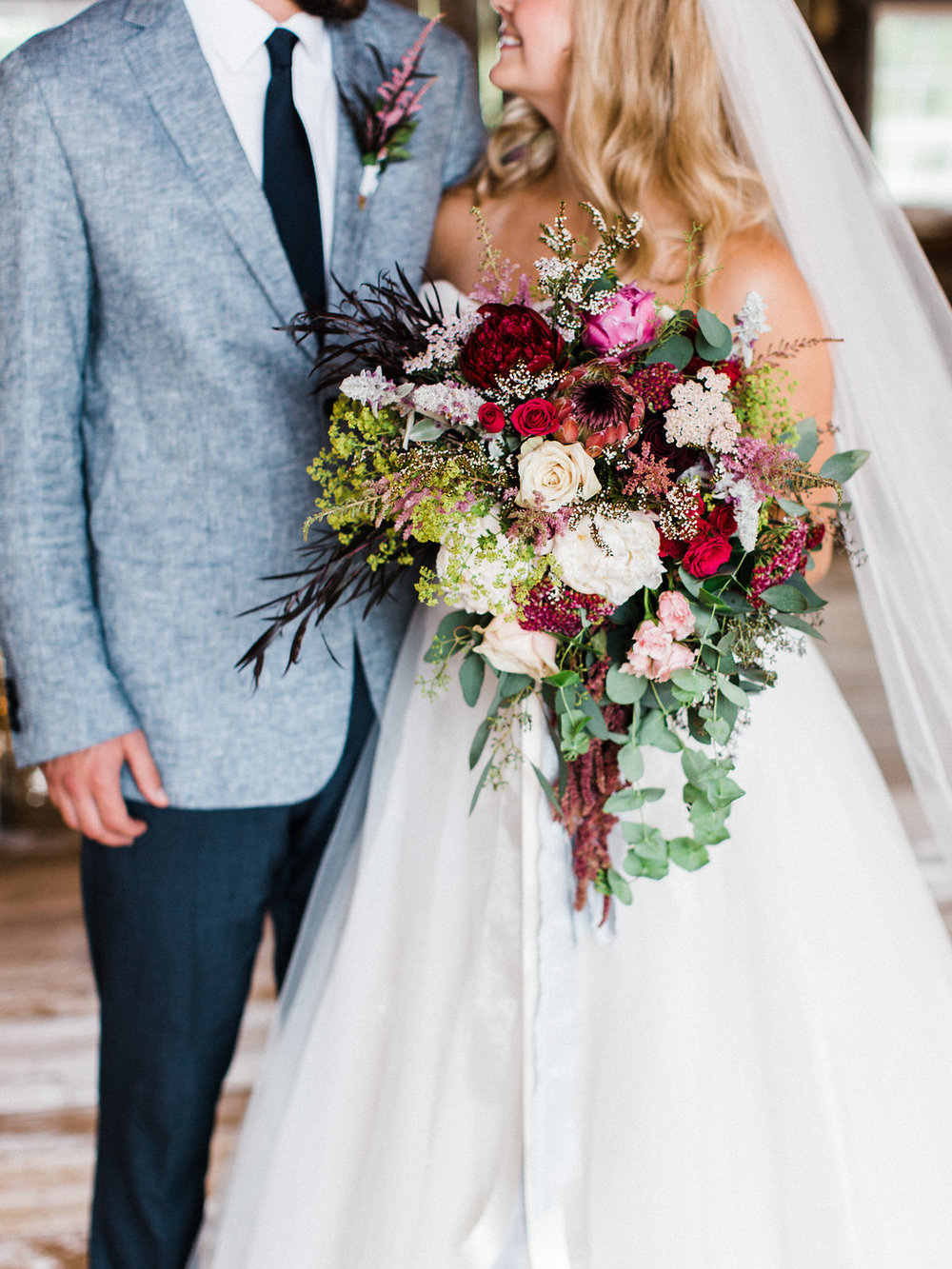 Couple posing with the flower bouquet