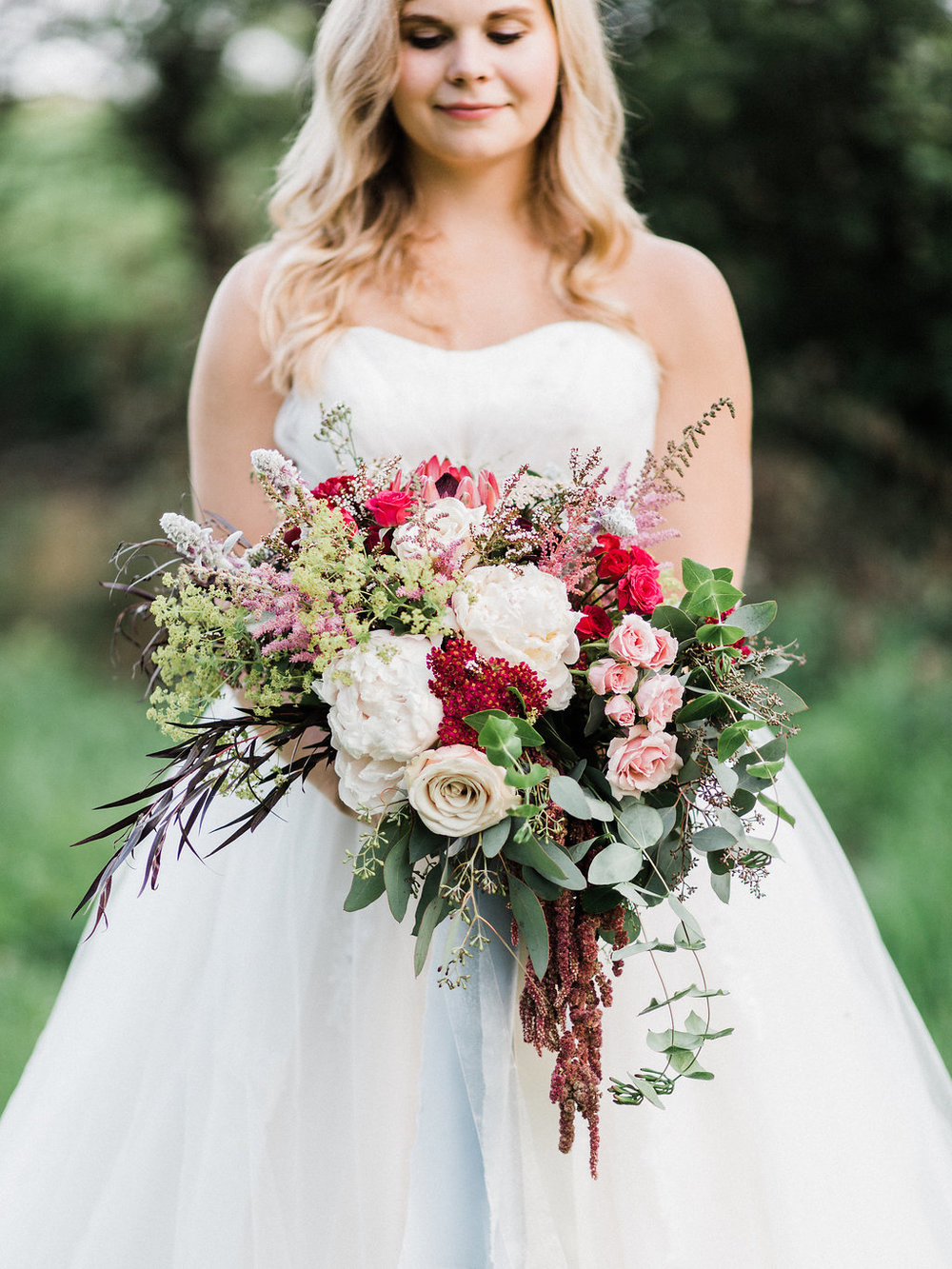 enchanting bride holding the bouquet