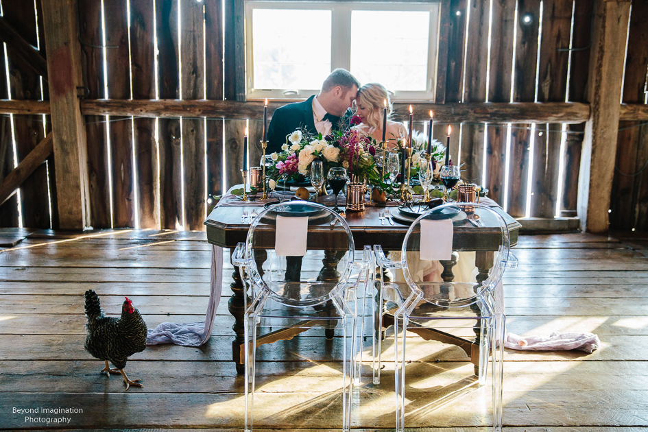 wedding head table newlyweds.JPG