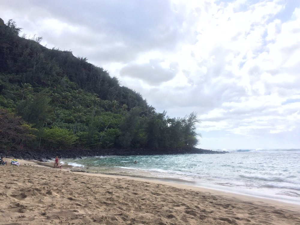 ke'e beach next to the trailhead. had to jump in, definitely earned it