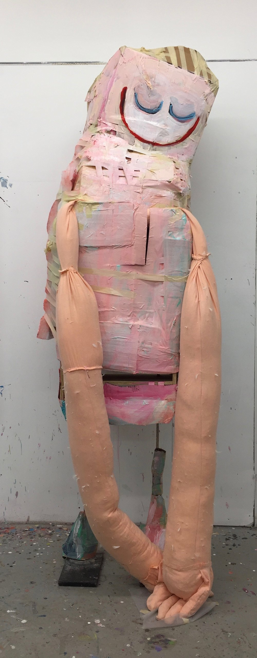 "Her Hugs (2017), Acrylic on cardboard, masking tape, batting, and wood frame on metal legs, 94"" x 36"" x 26"""