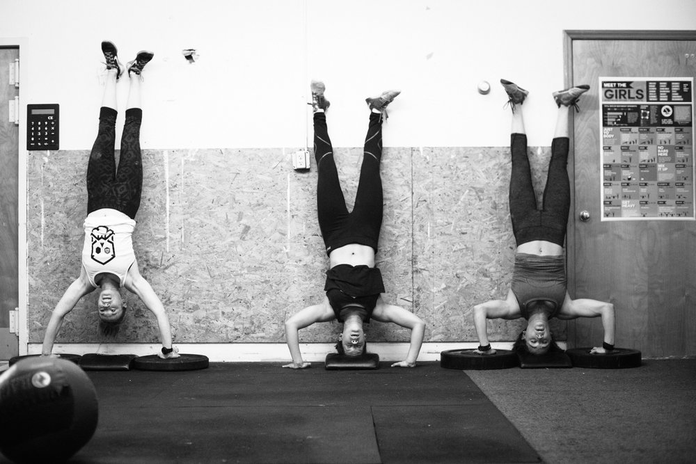 hand stand push ups - girls - women in fitness - asheville cross fit