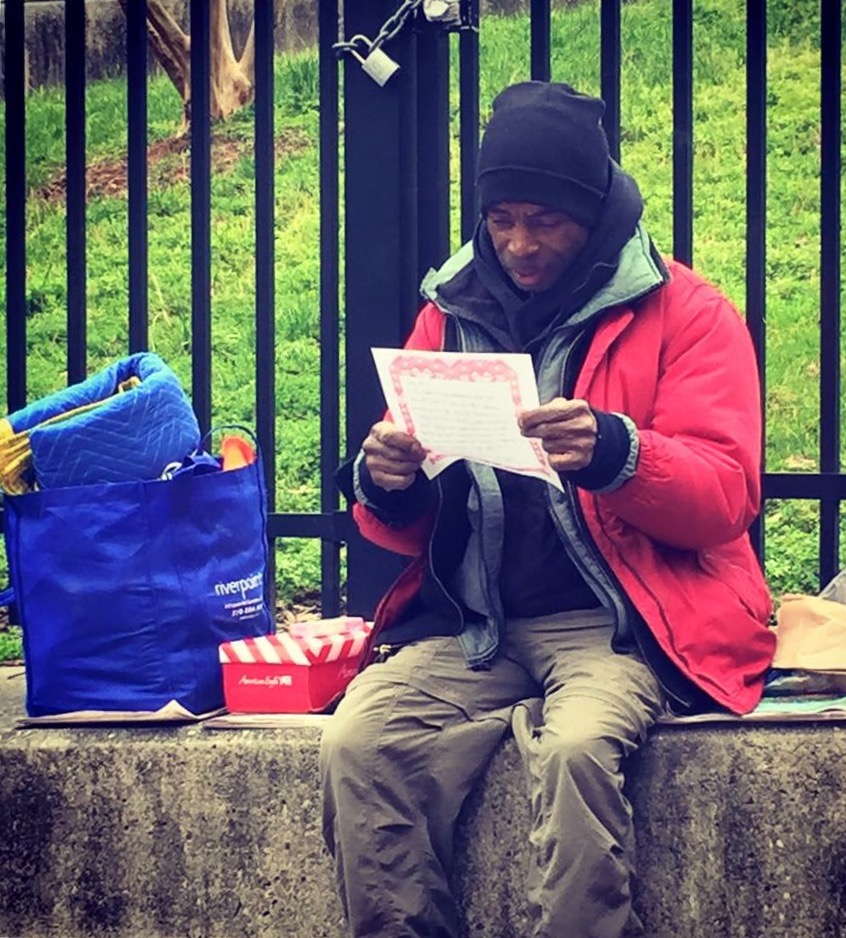 Streets 2016 man with letter.jpg