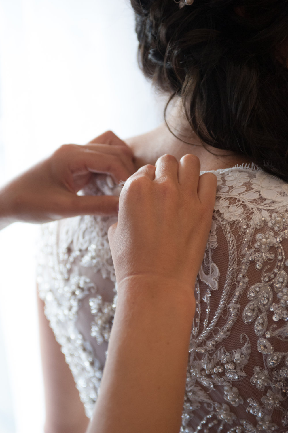 brides dress being buttoned