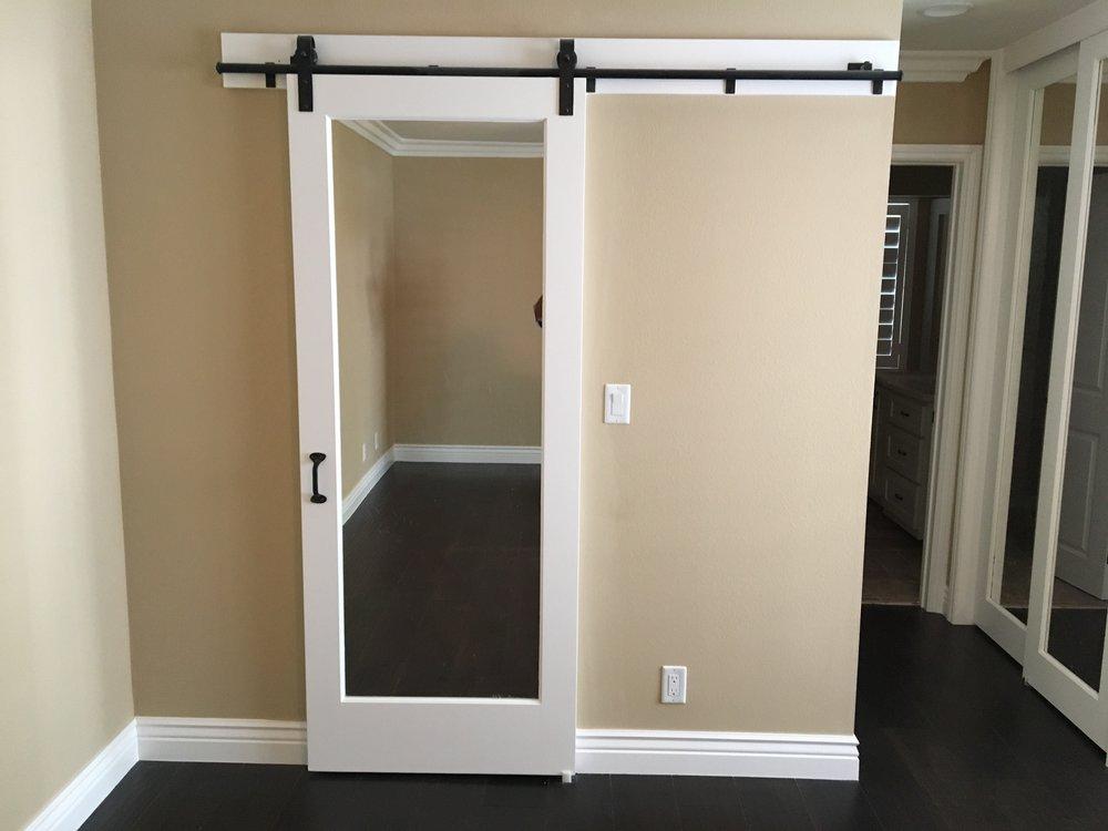 Barn doors deco door and crown for Mirrored barn door