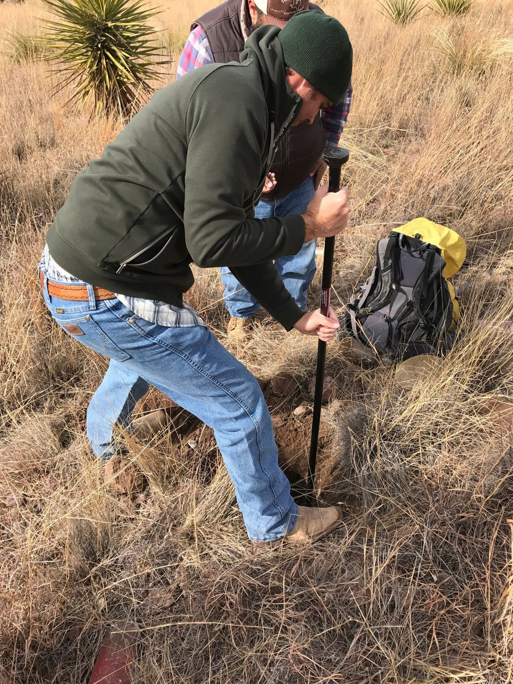 Will Juett, soil scientist from the NRCS in Marfa, digging through rocks.