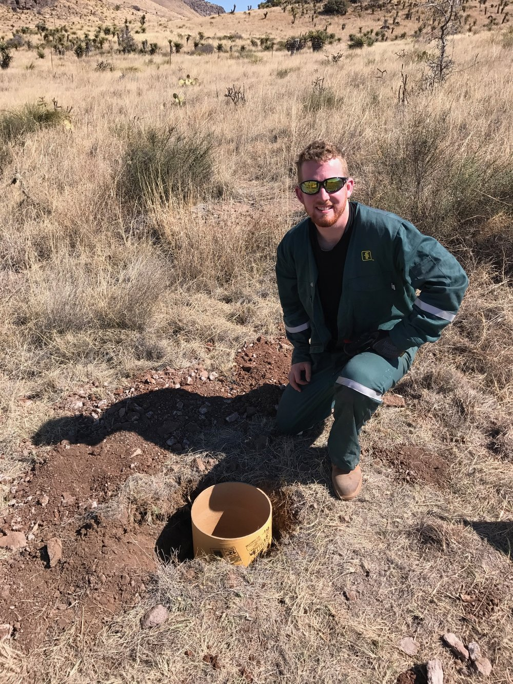 George next to the first finished footing hole.