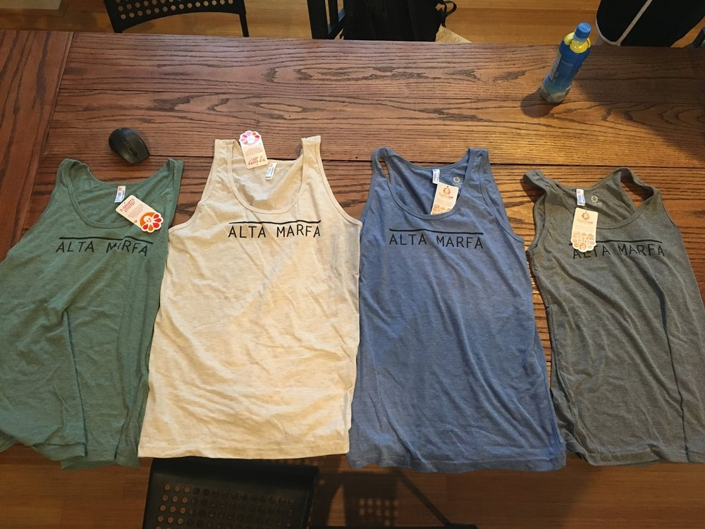 The shirts are American Apparel Tri-blend, they are super soft and run on the smaller side.