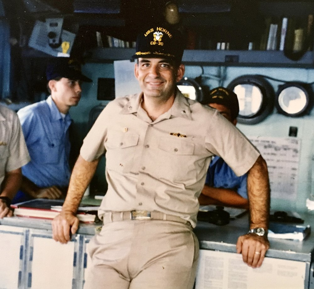 CDR R. E. Johnston on the bridge USS HORNE (CG-30) as Commanding Officer.