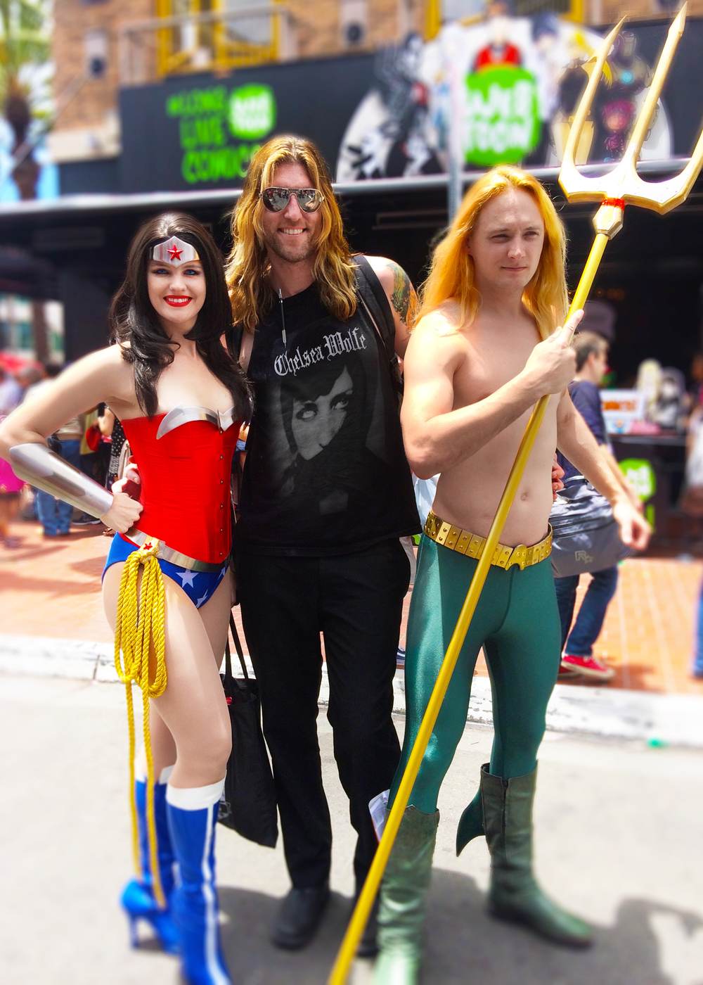 """COMIC-CON 2015 Edition: Wonder Woman, THOR [me] and Aquaman. Contrary to popular Norse mythology, THOR actually wears a CHELSEA WOLFE shirt [beautiful gothic musician high-priestess of folk] and NOT cape and wears aviator sunglasses to protect """"his"""" eyes being the GOD of THUNDER and all…….."""