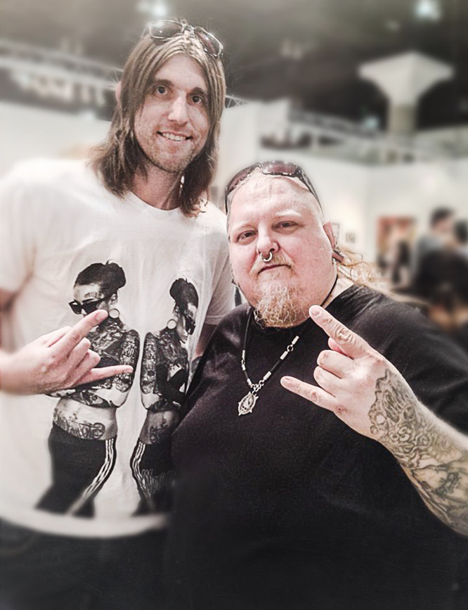 With the renowned  LA ART SHOW 2015  taking place this weekend at the LA Convention Center, here's a   #flashback   photo with myself and Mr.  PAUL BOOTH  [the BEST *dark* tattoo artist in the world and a SUPER swell guy] pictured at last year's  2014 LA Art Show .    www.bryanbarnesart.com