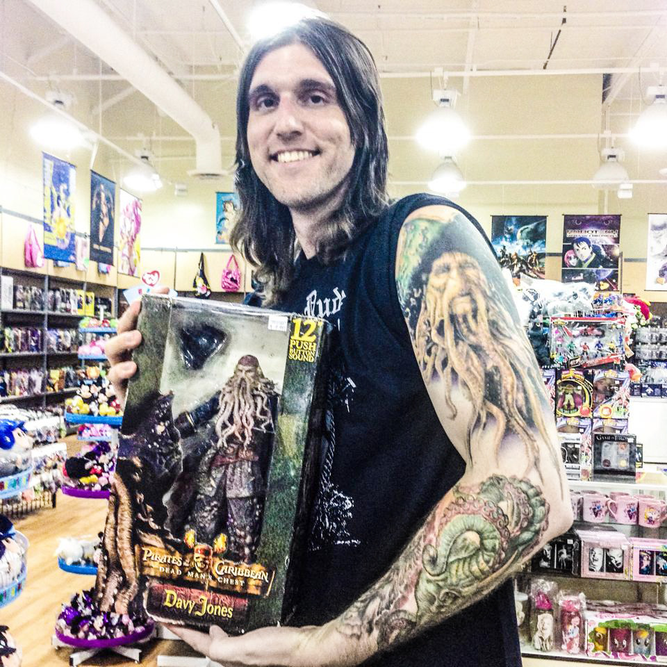 Totally nerding out at the comic store in Carlsbad [California] Comics-N-Stuff with my matching tattoo Disney Pirates of the Caribbean DAVY JONES and new movie figure!!! [all tattoo work done by Cecil Porter].