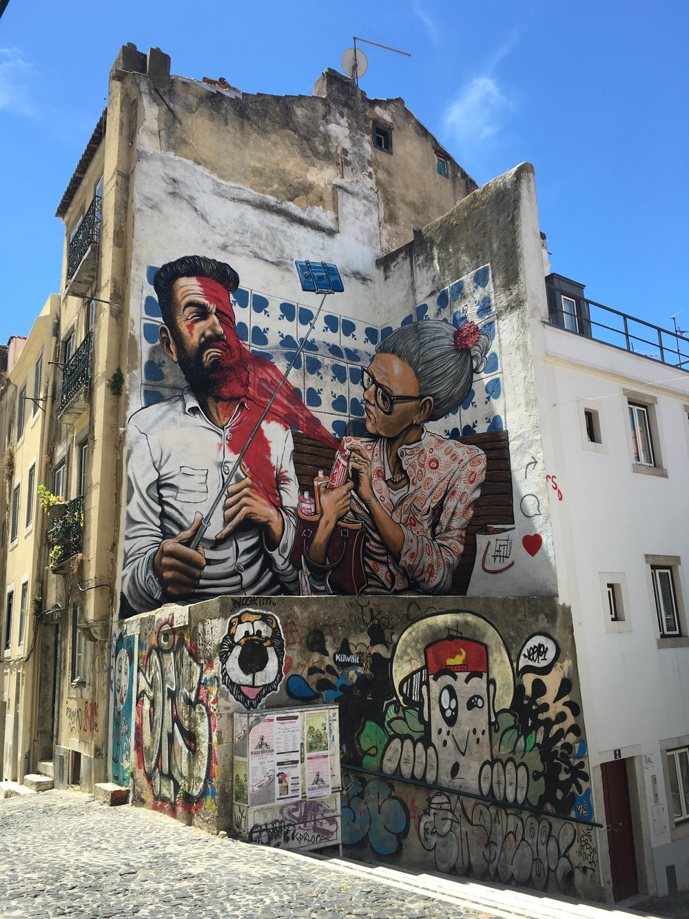 Street art and graffiti is ever present on Lisbon's storied walls. Photo by Justin Salhani.
