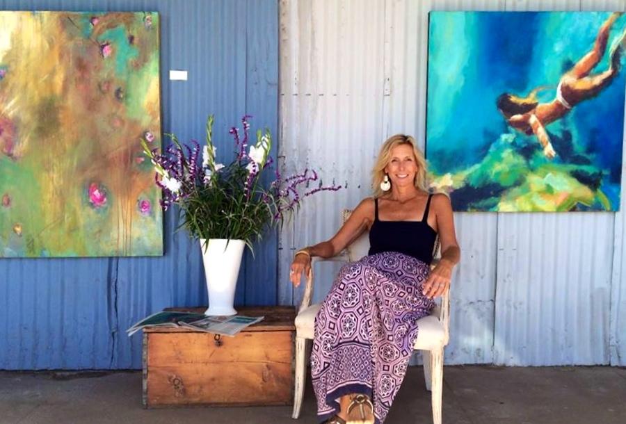 Carrie in front of her studio