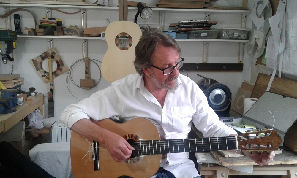 Rob Johns trying out a new Roy Courtnall guitar in the workshop.