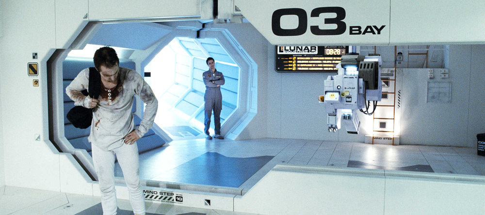 Moon , 2009, film still showing a decaying old Sam, the new Sam and Gerty, dir. Duncan Jones.